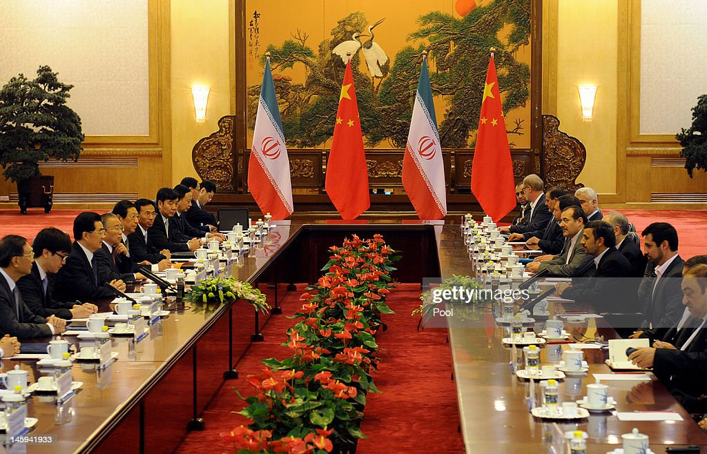 Chinese President Hu Jintao (Center-L) attends a bilateral meeting with Iran's President Mahmoud Ahmadinejad (Center-R) at the Great Hall of the People on June 8, 2012 in Beijing, China. According to reports, China announced that it will provide a 150 million yuan (23.8 million US dollars) grant to the Afghan government during 2012.