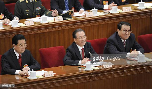 Chinese President Hu Jintao Chinese Premier Wen Jiabao and Chinese politburo member Li Changchun take part in the closing session of the National...