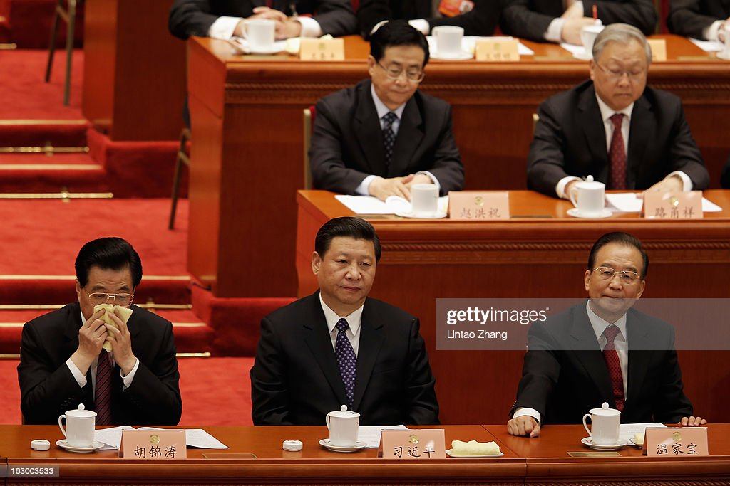 Chinese President Hu Jintao, Communist Party chief Xi Jinping and Chinese Premier Wen Jiabao attend the opening session of the Chinese People's Political Consultative Conference at Great Hall of the People on March 3, 2013 in Beijing, China. Over 2000 members of the 12th National Committee of the Chinese People's Political Consultative, a political advisory body, are attending the annual session, during which they will discuss the development of China.
