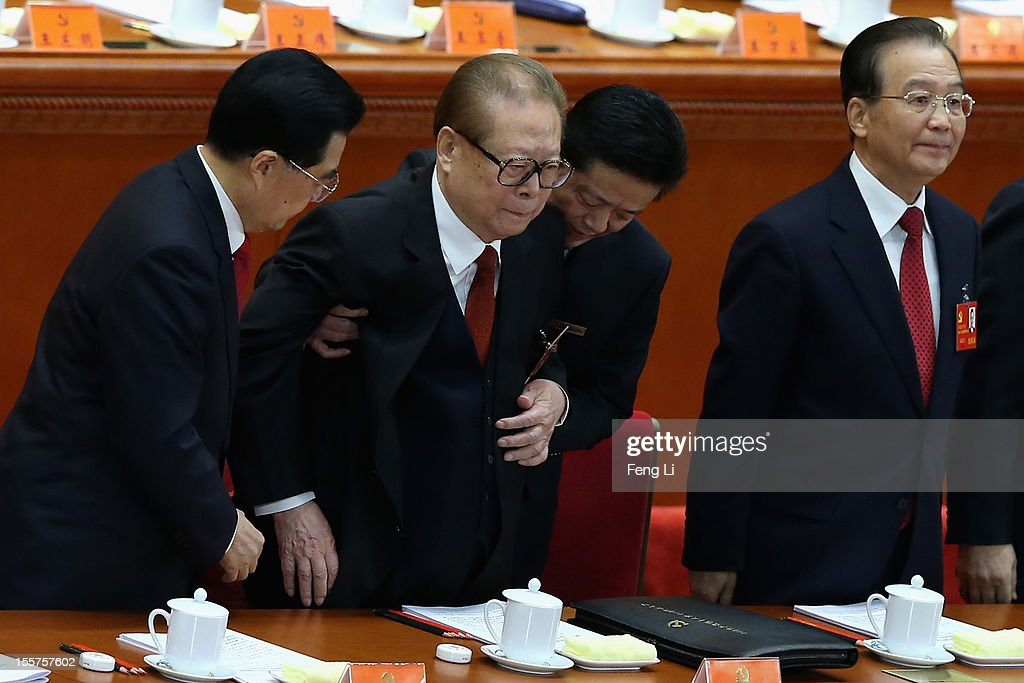 Chinese President Hu Jintao former Chinese President Jiang Zemin and Chinese Prime Minister Wen Jiabao attend the opening session of the 18th...