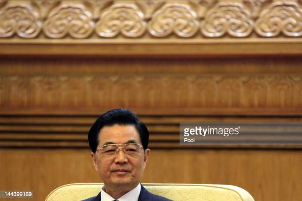 Chinese President Hu Jintao holds a meeting with his South Korean counterpart Lee Myungbak and Japan's Prime Minister Yoshihiko Noda during the fifth...