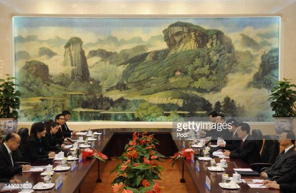 Chinese President Hu Jintao holds talks with Thailand's Prime Minister Yingluck Shinawatra at the Great Hall of the People on April 18 2012 in...