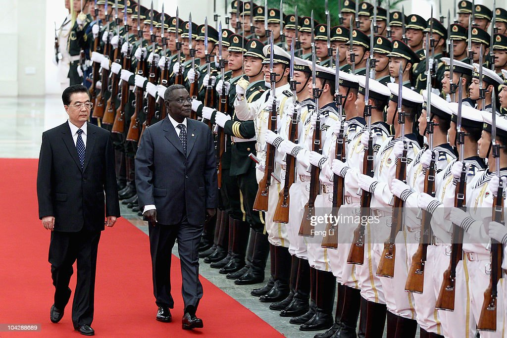 Chinese President <a gi-track='captionPersonalityLinkClicked' href=/galleries/search?phrase=Hu+Jintao&family=editorial&specificpeople=203109 ng-click='$event.stopPropagation()'>Hu Jintao</a> (L) invites Ghana's President <a gi-track='captionPersonalityLinkClicked' href=/galleries/search?phrase=John+Atta+Mills&family=editorial&specificpeople=2650122 ng-click='$event.stopPropagation()'>John Atta Mills</a> (R) to view an honour guard during a welcoming ceremony inside the Great Hall of the People on September 20, 2010 in Beijing, China. Ghana's President <a gi-track='captionPersonalityLinkClicked' href=/galleries/search?phrase=John+Atta+Mills&family=editorial&specificpeople=2650122 ng-click='$event.stopPropagation()'>John Atta Mills</a> are visiting to China from September 19 to 24 2010.