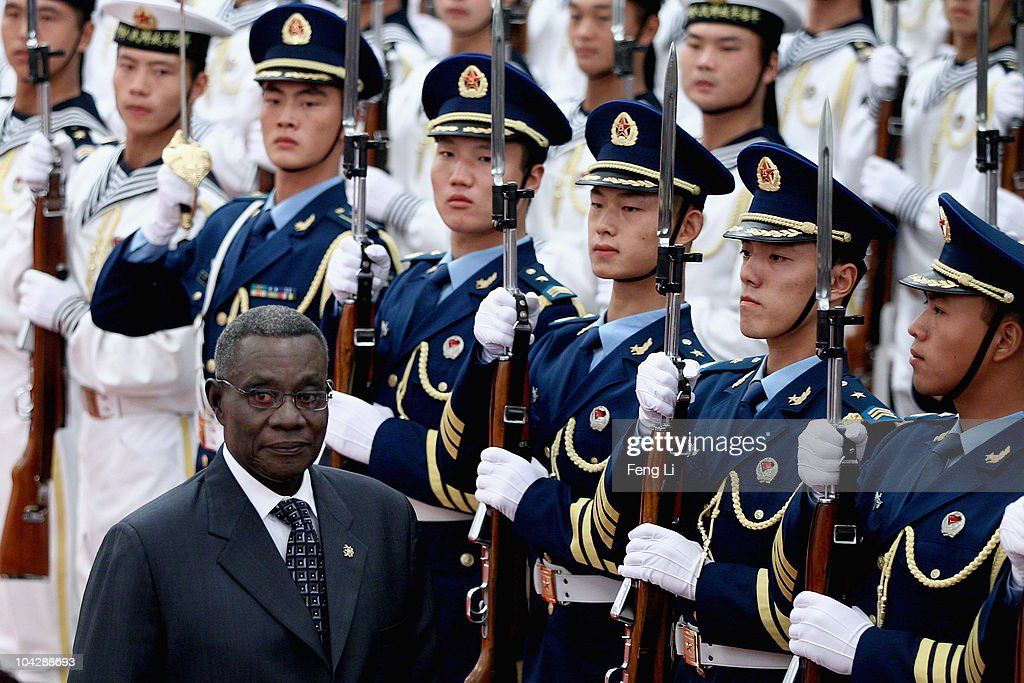 Chinese President Hu Jintao invites Ghana's President <a gi-track='captionPersonalityLinkClicked' href=/galleries/search?phrase=John+Atta+Mills&family=editorial&specificpeople=2650122 ng-click='$event.stopPropagation()'>John Atta Mills</a> (L) to view an honour guard during a welcoming ceremony inside the Great Hall of the People on September 20, 2010 in Beijing, China. Ghana's President <a gi-track='captionPersonalityLinkClicked' href=/galleries/search?phrase=John+Atta+Mills&family=editorial&specificpeople=2650122 ng-click='$event.stopPropagation()'>John Atta Mills</a> are visiting to China from September 19 to 24 2010.
