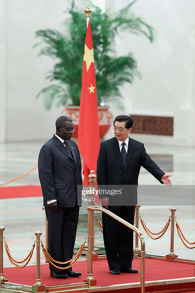 Chinese President <a gi-track='captionPersonalityLinkClicked' href=/galleries/search?phrase=Hu+Jintao&family=editorial&specificpeople=203109 ng-click='$event.stopPropagation()'>Hu Jintao</a> (R) invites Ghana's President <a gi-track='captionPersonalityLinkClicked' href=/galleries/search?phrase=John+Atta+Mills&family=editorial&specificpeople=2650122 ng-click='$event.stopPropagation()'>John Atta Mills</a> (L) to view an honour guard during a welcoming ceremony inside the Great Hall of the People on September 20, 2010 in Beijing, China. Ghana's President <a gi-track='captionPersonalityLinkClicked' href=/galleries/search?phrase=John+Atta+Mills&family=editorial&specificpeople=2650122 ng-click='$event.stopPropagation()'>John Atta Mills</a> are visiting to China from September 19 to 24 2010.