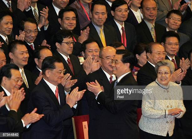 Chinese President Hu Jintao Lien Chan former chairman of Taiwan's opposition Kuomintang and other delegates from the CrossStrait Economic and Trade...