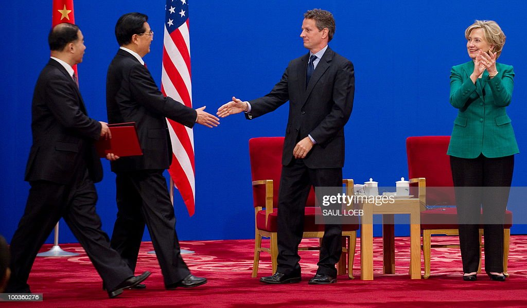Chinese President Hu Jintao (2nd L) reaches out to shakes hands with US Treasury Secretary Timothy Geithner alongside US Secretary of State Hillary Clinton (R) during the opening session of the second round of the US-China Strategic & Economic Dialogue at the Great Hall of the People in Beijing on May 24, 2010. The US and China opened two days of high-level talks due to cover a wide range of issues including tensions over the sinking of a South Korean warship, blamed on Pyongyang. AFP PHOTO / POOL / Saul LOEB