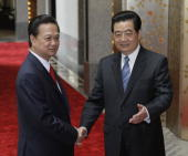 Chinese President Hu Jintao receives Vietnamese Prime Minister Nguyen Tan Dung on April 30 2010 in Shanghai China The Presidents held talks which...