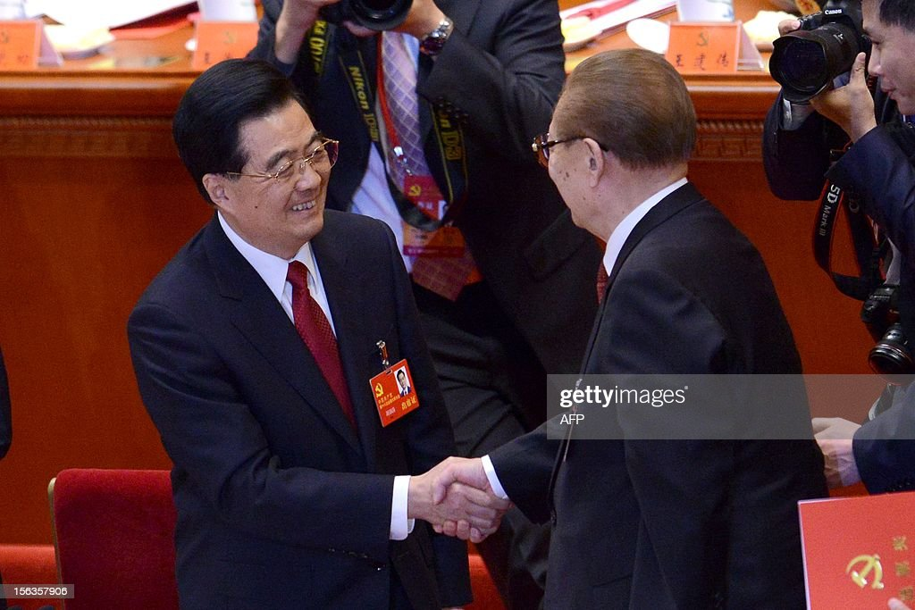 Chinese President Hu Jintao (L) shakes hands with former president Jiang Zemin (R) after the closing of the 18th Communist Party Congress at the Great Hall of the People in Beijing on 14 November 2012. The week-long Communist Party Congress will end with a transition of power to Chinese Vice President Xi Jinping, who will govern for the coming decade amid growing pressure for reform of the communist regime's iron-clad grip on power.