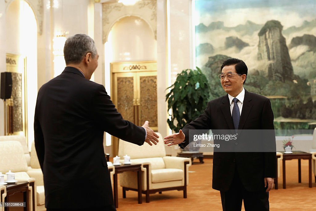 Chinese President <a gi-track='captionPersonalityLinkClicked' href=/galleries/search?phrase=Hu+Jintao&family=editorial&specificpeople=203109 ng-click='$event.stopPropagation()'>Hu Jintao</a> (R) shakes hands with Singapore Prime Minister <a gi-track='captionPersonalityLinkClicked' href=/galleries/search?phrase=Lee+Hsien+Loong&family=editorial&specificpeople=3911578 ng-click='$event.stopPropagation()'>Lee Hsien Loong</a> (L) at the Great Hall of the People on September 4, 2012 in Beijing, China. On the afternoon of September 2, Singapore Prime Minister <a gi-track='captionPersonalityLinkClicked' href=/galleries/search?phrase=Lee+Hsien+Loong&family=editorial&specificpeople=3911578 ng-click='$event.stopPropagation()'>Lee Hsien Loong</a> arrived in Chengdu, Sichuan, to began a six-day official visit to China.
