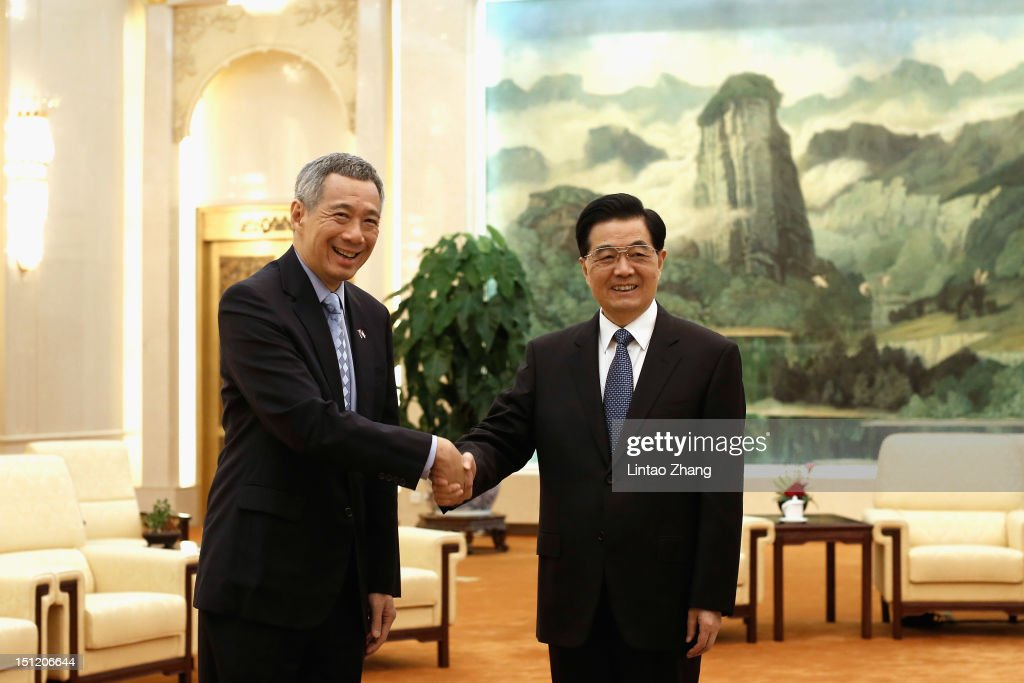 Chinese President Hu Jintao shakes hands with Singapore Prime Minister Lee Hsien Loong at the Great Hall of the People on September 4 2012 in Beijing...