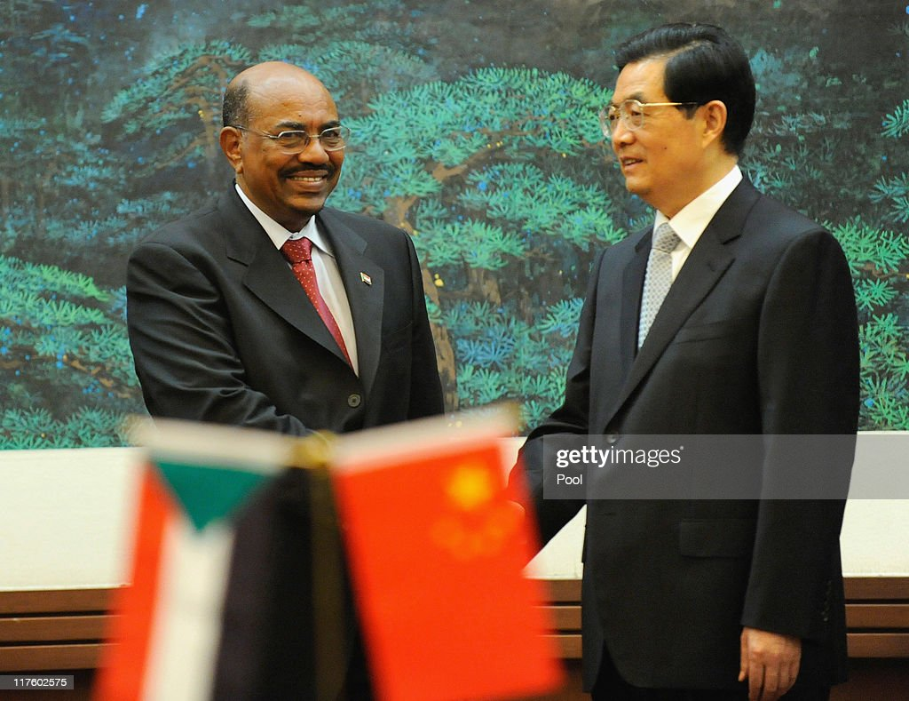 Chinese President Hu Jintao (R) shakes hands with Sudan's leader <a gi-track='captionPersonalityLinkClicked' href=/galleries/search?phrase=Omar+al-Bashir&family=editorial&specificpeople=588924 ng-click='$event.stopPropagation()'>Omar al-Bashir</a> (L) during the signing ceremony at the Great Hall of the People on June 29, 2011 in Beijing, China. <a gi-track='captionPersonalityLinkClicked' href=/galleries/search?phrase=Omar+al-Bashir&family=editorial&specificpeople=588924 ng-click='$event.stopPropagation()'>Omar al-Bashir</a>, who is wanted by the International Criminal Court for alleged war crimes, is on a four-day visit to China.