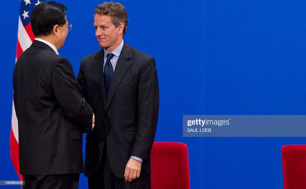 Chinese President Hu Jintao (L) shakes hands with US Treasury Secretary Timothy Geithner during the opening session of the second round of the US-China Strategic & Economic Dialogue at the Great Hall of the People in Beijing on May 24, 2010. The US and China opened two days of high-level talks due to cover a wide range of issues including tensions over the sinking of a South Korean warship, blamed on Pyongyang. AFP PHOTO / POOL / Saul LOEB