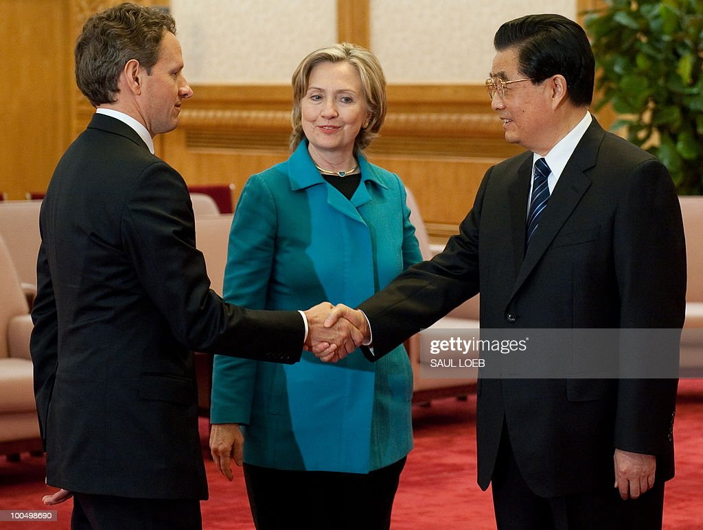 Chinese President Hu Jintao shakes hands with US Treasury Secretary Timothy Geithner (L) alongside US Secretary of State Hillary Clinton (C) prior to meetings at the Great Hall of the People in Beijing on May 25, 2010. Clinton said two days of high-level Sino-US talks had been 'very productive' but admitted differences remained, especially on economic and trade issues. AFP PHOTO / POOL / Saul LOEB