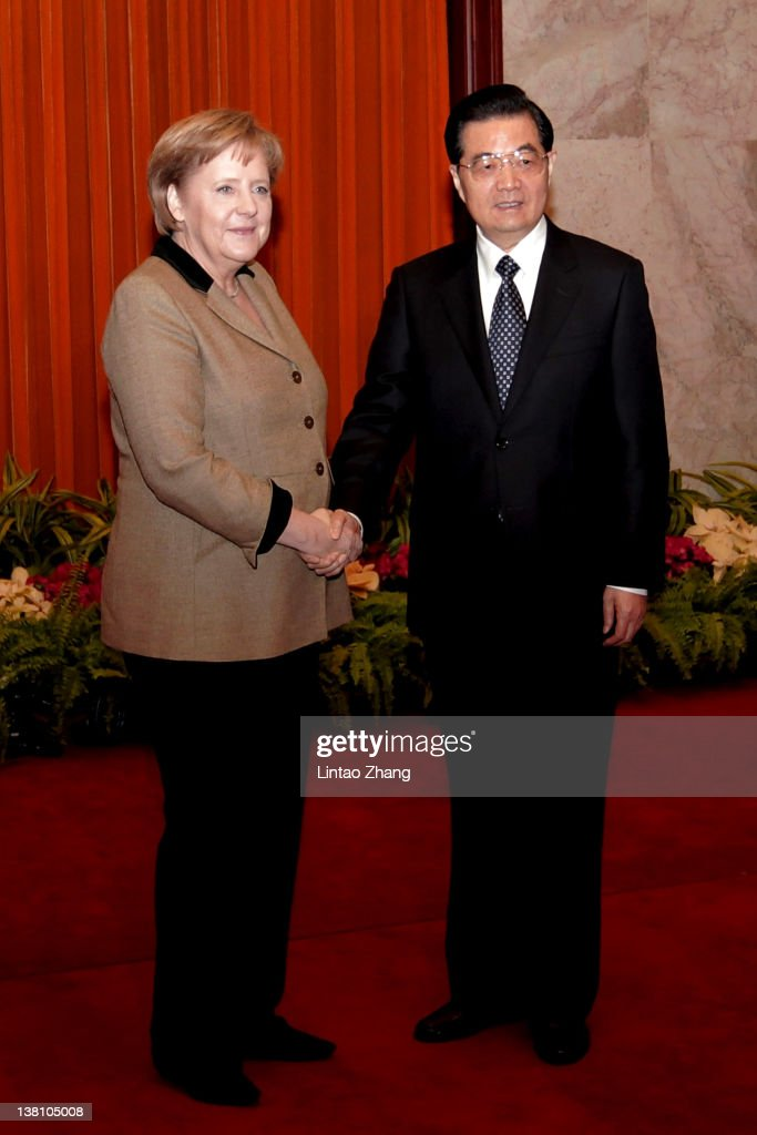 Chinese President Hu Jintao shankes hands with German Chancellor Angela Merkel at the Great Hall of the People on February 3 2012 in Beijing China...