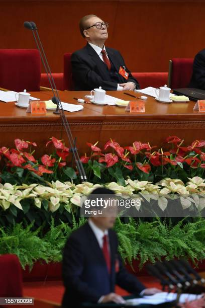 Chinese President Hu Jintao speaks as former Chinese President Jiang Zemin sitting behind during the opening session of the 18th Communist Party...