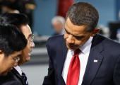 Chinese President Hu Jintao speaks with US President Barack Obama at the plenary session of the G20 summit on September 25 2009 in Pittsburgh...