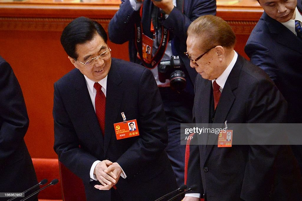 Chinese President Hu Jintao (L) talks with Chinese former president Jian Zemin(R) after the closing of the 18th Communist Party Congress at the Great Hall of the People in Beijing on 14 November 2012. The week-long Communist Party Congress will end with a transition of power to Chinese Vice President Xi Jinping, who will govern for the coming decade amid growing pressure for reform of the communist regime's iron-clad grip on power. AFP PHOTO/WANG ZHAO
