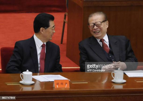 Chinese president Hu jintao talks with former president Jiang Zemin at the commemoration of the 100th anniversary of the Xinhai Revolution at the...