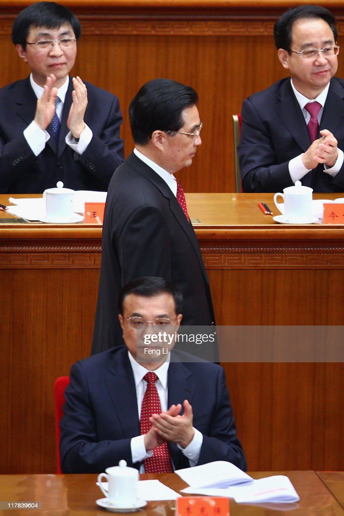 Chinese President Hu Jintao (Center) walks back to his seat after a speech during the celebration of the Communist Party's 90th anniversary at the Great Hall of the People on July 1, 2011 in Beijing, China.