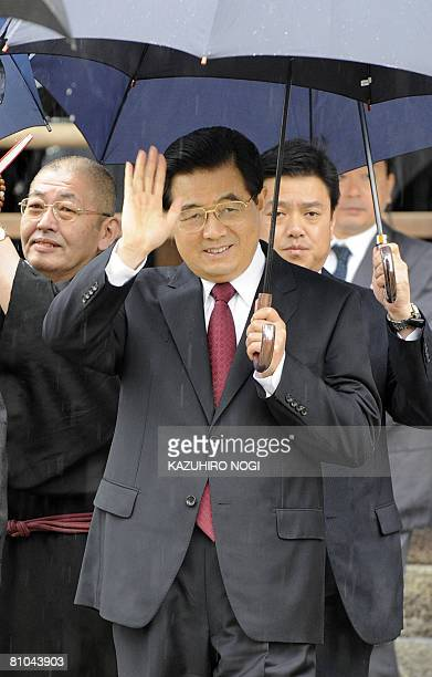 Chinese President Hu Jintao waves to the media on his visit to the Horyuji temple in Ikaruga Nara Prefecture on May 10 2008 Hu is to visit tourist...