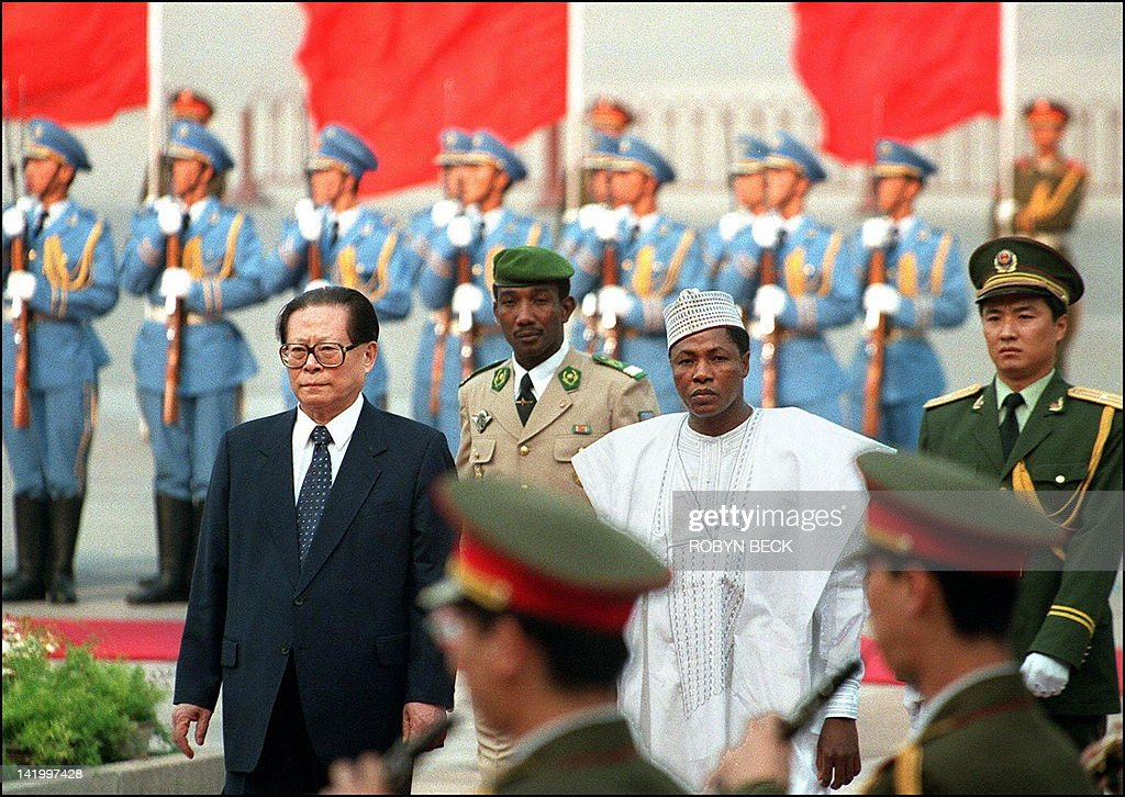 Chinese President Jiang Zemin accompanies Niger President Ibrahim Barre Mainassara as he reviews the honor guard during the welcoming ceremony in...