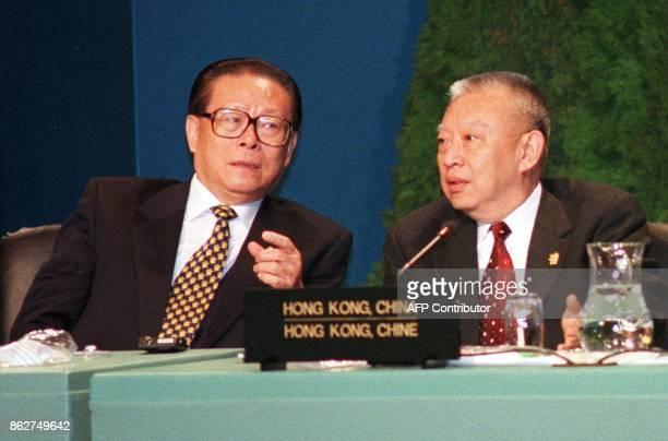 Chinese President Jiang Zemin chats with Hong Kong's Chief Executive Tung Cheehwa following their 5th APEC Economic Leaders Meeting 24 November in...