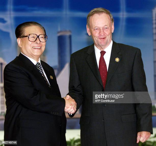 Chinese President Jiang Zemin greets Canadian Prime Minister Jean Chretien before the start of the AsiaPacific Economic Cooperation summit in...