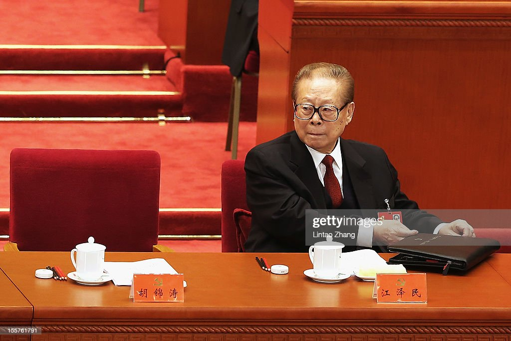 Chinese President Jiang Zemin prepares to leave the opening session of the 18th Communist Party Congress held at the Great Hall of the People on...
