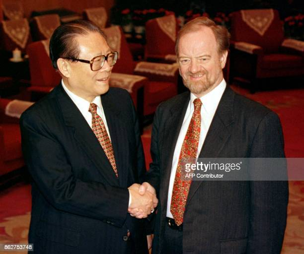 Chinese President Jiang Zemin shakes hands with British Foreign Secretary Robin Cook before talks in the leaders' compound Zhongnanhai in Beijing 20...