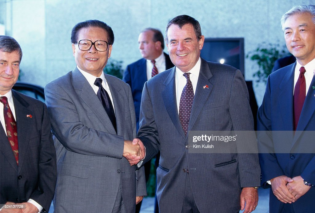 Chinese President <a gi-track='captionPersonalityLinkClicked' href=/galleries/search?phrase=Jiang+Zemin&family=editorial&specificpeople=159399 ng-click='$event.stopPropagation()'>Jiang Zemin</a> shakes hands with General Motors' president and CEO John F. Smith Jr. during a visit to the Hughes Electronics Corporation, a leading provider of digital television entertainment, in Los Angeles, California. To the left of President Zemin is Hughes' chairman and CEO Michael T. Smith.