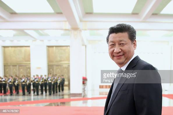 Chinese President Xi Jinping accompanies Armenian President Serzh Sargsyan to view an honour guard during a welcoming ceremony inside the Great Hall...