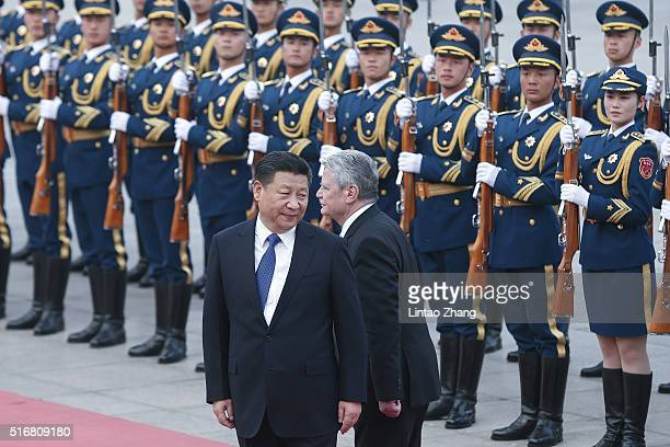 Chinese President Xi Jinping accompanies German President Joachim Gauck to view an honour guard during a welcoming ceremony inside the Great Hall of...