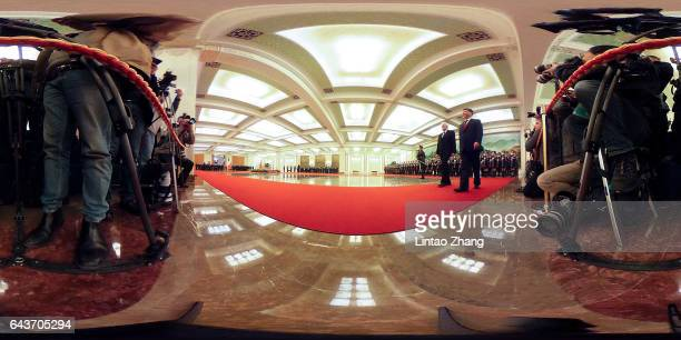 Chinese President Xi Jinping accompanies Italian President Sergio Mattarella to view an honour guard during a welcoming ceremony inside the Great...