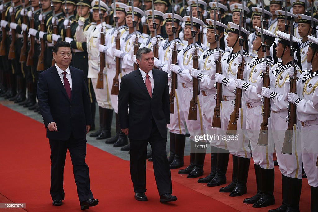Chinese President <a gi-track='captionPersonalityLinkClicked' href=/galleries/search?phrase=Xi+Jinping&family=editorial&specificpeople=2598986 ng-click='$event.stopPropagation()'>Xi Jinping</a> (Left) accompanies King Abdullah II Ibn Al Hussein of Jordan (Right) to view an honour guard during a welcoming ceremony at the Great Hall of People on September 18, 2013 in Beijing, China. At the invitation of Chinese President <a gi-track='captionPersonalityLinkClicked' href=/galleries/search?phrase=Xi+Jinping&family=editorial&specificpeople=2598986 ng-click='$event.stopPropagation()'>Xi Jinping</a>, King Abdullah II Ibn Al Hussein of Jordan paid a state visit to China from September 15 to 18.