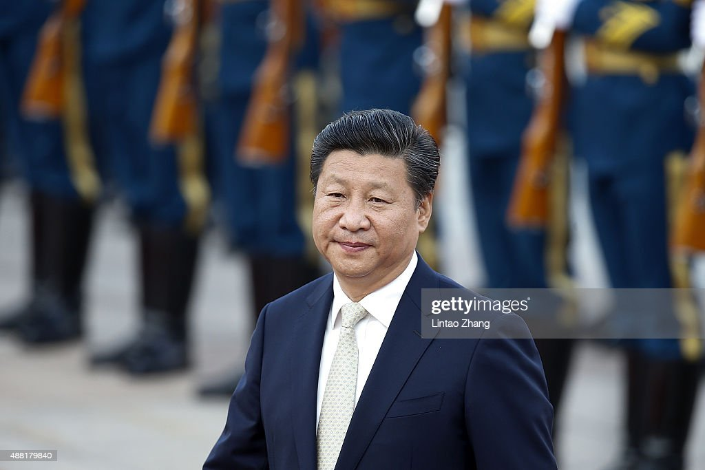 Chinese President <a gi-track='captionPersonalityLinkClicked' href=/galleries/search?phrase=Xi+Jinping&family=editorial&specificpeople=2598986 ng-click='$event.stopPropagation()'>Xi Jinping</a> accompanies Mauritania's President Mohamed Ould Abdel Aziz (not pictured) to view an honour guard during a welcoming ceremony outside the Great Hall of the People on September 14, 2015 in Beijing, China. Invited by President <a gi-track='captionPersonalityLinkClicked' href=/galleries/search?phrase=Xi+Jinping&family=editorial&specificpeople=2598986 ng-click='$event.stopPropagation()'>Xi Jinping</a>, Mauritanian President Aziz is on a state visit to China from September 9 to 16.