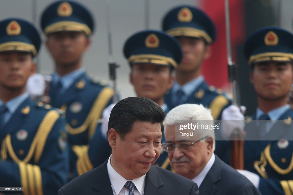 Chinese President Xi Jinping (Left) accompanies Palestinian President Mahmoud Abbas (Right) to view an honour guard during a welcoming ceremony outside the Great Hall of the People on May 6, 2013 in Beijing, China.