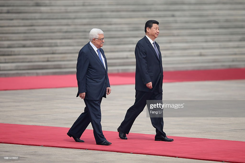Chinese President Xi Jinping (Right) accompanies Palestinian President Mahmoud Abbas (Left) to view an honour guard during a welcoming ceremony outside the Great Hall of the People on May 6, 2013 in Beijing, China.