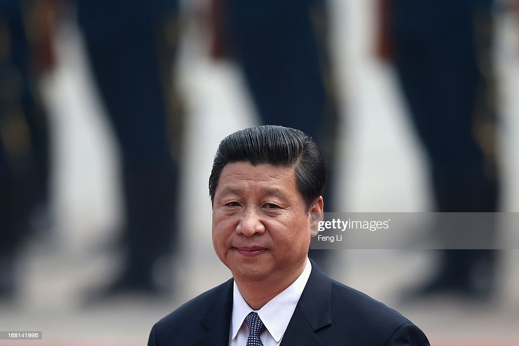 Chinese President <a gi-track='captionPersonalityLinkClicked' href=/galleries/search?phrase=Xi+Jinping&family=editorial&specificpeople=2598986 ng-click='$event.stopPropagation()'>Xi Jinping</a> accompanies Palestinian President Mahmoud Abbas to view an honour guard during a welcoming ceremony outside the Great Hall of the People on May 6, 2013 in Beijing, China.