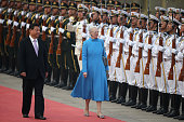 Chinese President Xi Jinping accompanies Queen Margrethe II of Denmark to view an honour guard during a welcoming ceremony outside the Great Hall of...