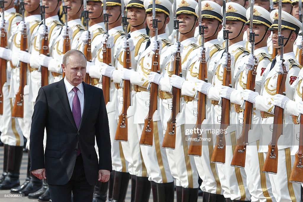 Chinese President <a gi-track='captionPersonalityLinkClicked' href=/galleries/search?phrase=Xi+Jinping&family=editorial&specificpeople=2598986 ng-click='$event.stopPropagation()'>Xi Jinping</a> (not pictured) accompanies Russian President <a gi-track='captionPersonalityLinkClicked' href=/galleries/search?phrase=Vladimir+Putin&family=editorial&specificpeople=154896 ng-click='$event.stopPropagation()'>Vladimir Putin</a> (R) to view an honour guard during a welcoming ceremony outside the Great Hall of the People on June 25, 2016 in Beijing, China. At the invitation of President <a gi-track='captionPersonalityLinkClicked' href=/galleries/search?phrase=Xi+Jinping&family=editorial&specificpeople=2598986 ng-click='$event.stopPropagation()'>Xi Jinping</a>, Russian President <a gi-track='captionPersonalityLinkClicked' href=/galleries/search?phrase=Vladimir+Putin&family=editorial&specificpeople=154896 ng-click='$event.stopPropagation()'>Vladimir Putin</a> is in China to discuss more economic and military cooperation between the two countries.