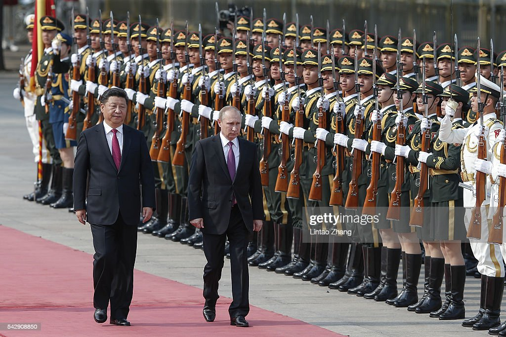 Chinese President <a gi-track='captionPersonalityLinkClicked' href=/galleries/search?phrase=Xi+Jinping&family=editorial&specificpeople=2598986 ng-click='$event.stopPropagation()'>Xi Jinping</a> (L) accompanies Russian President <a gi-track='captionPersonalityLinkClicked' href=/galleries/search?phrase=Vladimir+Putin&family=editorial&specificpeople=154896 ng-click='$event.stopPropagation()'>Vladimir Putin</a> (R) to view an honour guard during a welcoming ceremony outside the Great Hall of the People on June 25, 2016 in Beijing, China. At the invitation of President <a gi-track='captionPersonalityLinkClicked' href=/galleries/search?phrase=Xi+Jinping&family=editorial&specificpeople=2598986 ng-click='$event.stopPropagation()'>Xi Jinping</a>, Russian President <a gi-track='captionPersonalityLinkClicked' href=/galleries/search?phrase=Vladimir+Putin&family=editorial&specificpeople=154896 ng-click='$event.stopPropagation()'>Vladimir Putin</a> is in China to discuss more economic and military cooperation between the two countries.