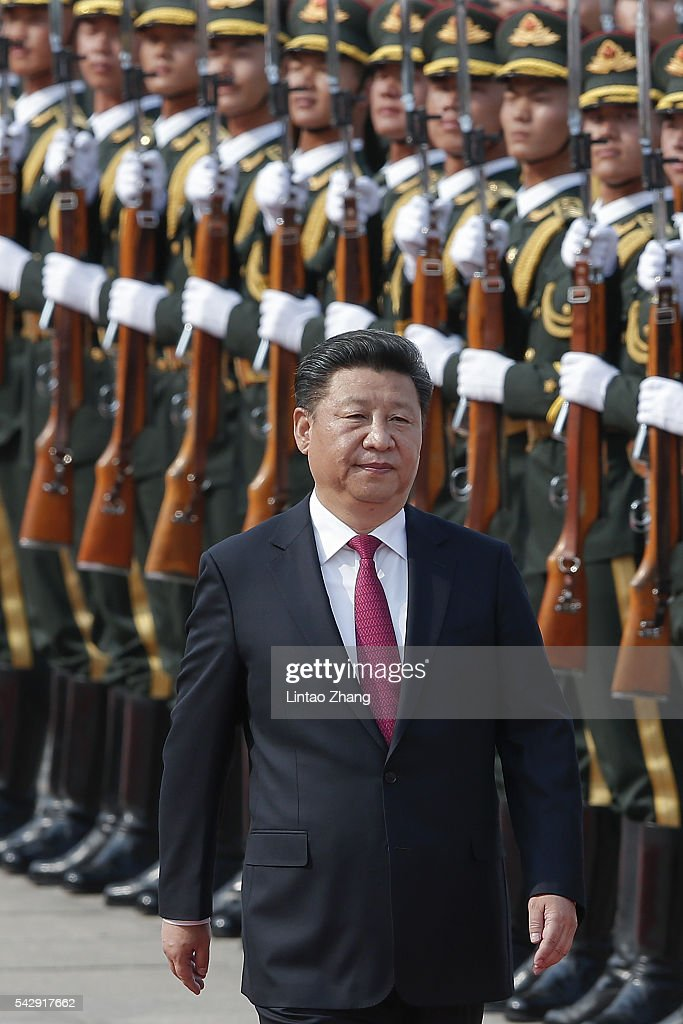 Chinese President Xi Jinping (L) accompanies Russian President Vladimir Putin (not pictured) to view an honour guard during a welcoming ceremony outside the Great Hall of the People on June 25, 2016 in Beijing, China. Russian President Vladimir Putin is in China to discuss more economic and military cooperation between the two countries.