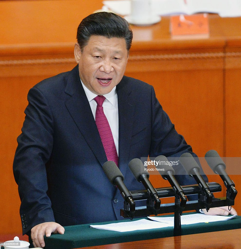 Chinese President <a gi-track='captionPersonalityLinkClicked' href=/galleries/search?phrase=Xi+Jinping&family=editorial&specificpeople=2598986 ng-click='$event.stopPropagation()'>Xi Jinping</a> addresses a ceremony at the Great Hall of the People in Beijing on July 1, 2016, to mark the 95th anniversary of the founding of the Chinese Communist Party.