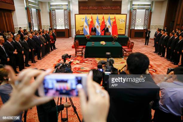 Chinese President Xi Jinping and Argentina's President Mauricio Macri attend a signing ceremony at the Great Hall of the People in Beijing on May 17...