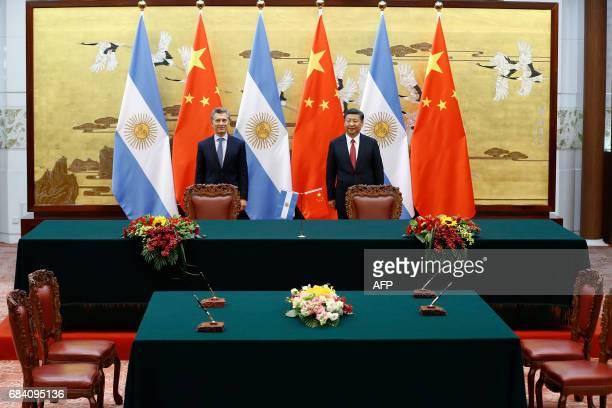 Chinese President Xi Jinping and Argentina's President Mauricio Macri attend a signing ceremony a signing ceremony at the Great Hall of the People in...