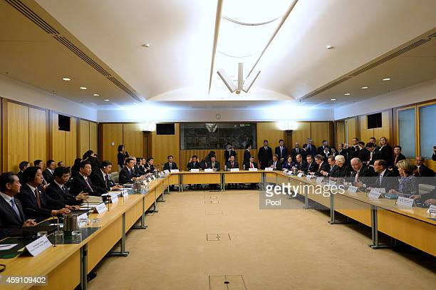 Chinese President Xi Jinping and Australian Prime Minister Tony Abbott attend a roundtable with Chinese and Australian business leaders at Parliament...