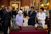 Chinese President Xi Jinping and China's First Lady Peng Liyuan with Britain's Queen Elizabeth II and Prince Philip Duke of Edinburgh view a display...