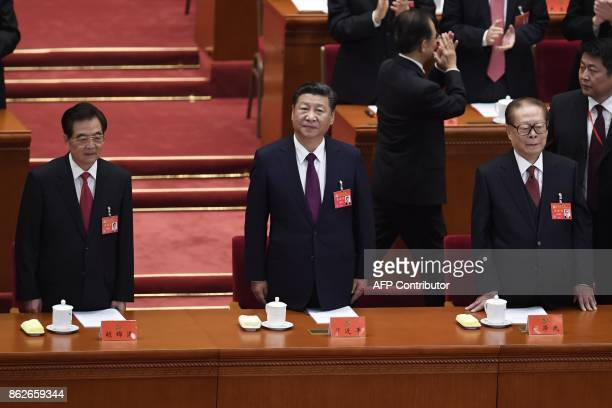 Chinese President Xi Jinping and Chinese former president Hu Jintao Chinese former president Jiang Zemin attend the opening session of the Chinese...