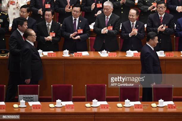 Chinese President Xi Jinping and Chinese former president Jiang Zemin attend the opening session of the Chinese Communist Party's Congress at the...